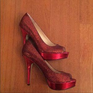 Enzo Angiolini red sparkly peep-toe heels.